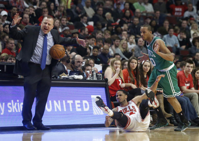 Chicago Bulls head coach Tom Thibodeau, left, reacts to an official after contact between Bulls point guard D.J. Augustin, center, and Boston Celtics point guard Avery Bradley (0) during the first half of an NBA basketball game on Thursday, Jan. 2, 2014, in Chicago. (AP Photo/Charles Rex Arbogast)