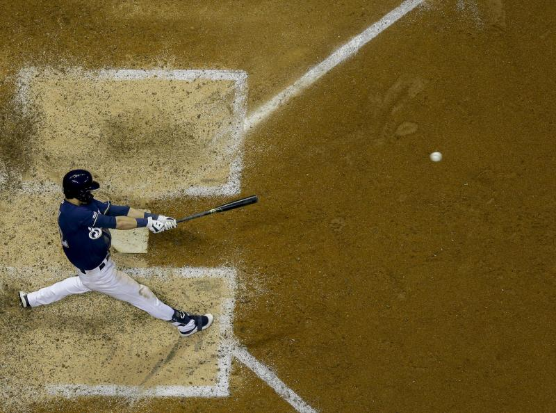 Milwaukee Brewers' Christian Yelich hits a grand slam during the seventh inning of a baseball game against the Atlanta Braves Tuesday, July 16, 2019, in Milwaukee. (AP Photo/Morry Gash)