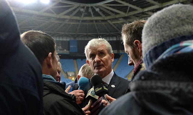 Mark Hughes, pictured talking to the media after the defeat at Coventry, had been in charge at Stoke City since May 2013.