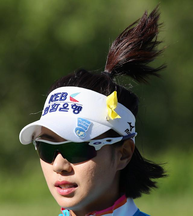 Last year's tournament winner Hee Young Park of South Korea jogs between holes on the way to shooting a 6-under par for a share of the lead at the Manulife Financial LPGA Classic Thursday, June 5, 2014 in Waterloo, Ontario. (AP Photo/The Canadian Press, Dave Chidley)