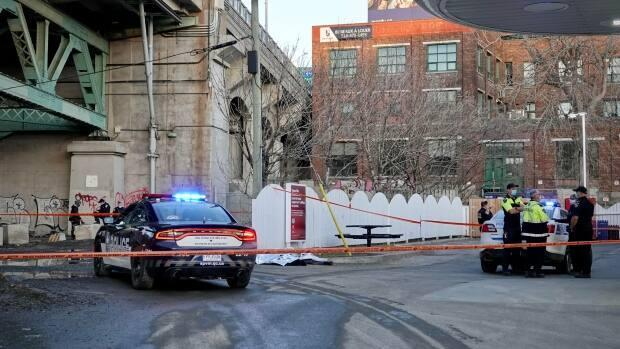 Police were called to the scene of a fatal collision involving a 26-year-old woman and a garbage truck at a gas station in downtown Montreal. (Simon-Marc Charron/Radio-Canada - image credit)