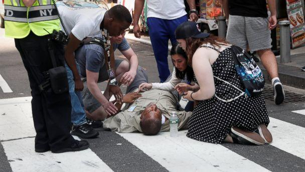 PHOTO: An injured man is helped on the sidewalk in Times Square after a speeding vehicle struck pedestrians on the sidewalk in New York City, May 18, 2017. (Mike Segar/Reuters)