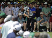 <p>Tiger Woods tees off on the seventh hole during the third round of the Masters golf tournament Saturday, April 11, 2015, in Augusta, Ga. (AP Photo/Matt Slocum) </p>