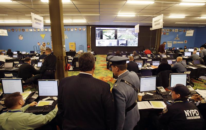 New Jersey Gov. Chris Christie, left, looks out over the Super Bowl security operations center Wednesday, Jan. 29, 2014, in East Rutherford, N.J. (AP Photo/Mel Evans,pool)