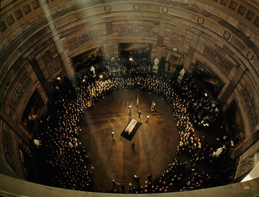 John F Kennedy's coffin lies in state beneath the Capitol's dome, November 1963.
