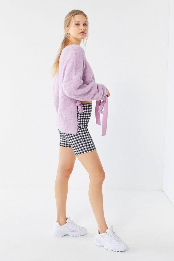 """<p><strong>Urban Outfitters</strong></p><p>urbanoutfitters.com</p><p><strong>$76.00</strong></p><p><a rel=""""nofollow"""" href=""""https://www.urbanoutfitters.com/shop/uo-eyelash-drawstring-hem-highlow-sweater"""">Shop Now</a></p><p>Looking to catch a warm breeze without your skirt flying up in public?  <a rel=""""nofollow"""" href=""""https://www.urbanoutfitters.com/shop/uo-kimmy-gingham-high-rise-bike-short"""">Bike shorts</a> have got you covered-literally. Complete the sporty look with <a rel=""""nofollow"""" href=""""https://www.urbanoutfitters.com/shop/fila-disruptor-2-premium-mono-sneaker"""">white dad sneakers</a> and a cozy sweater if it's still cool outside (it's not summer <em>yet</em>, after all).</p>"""