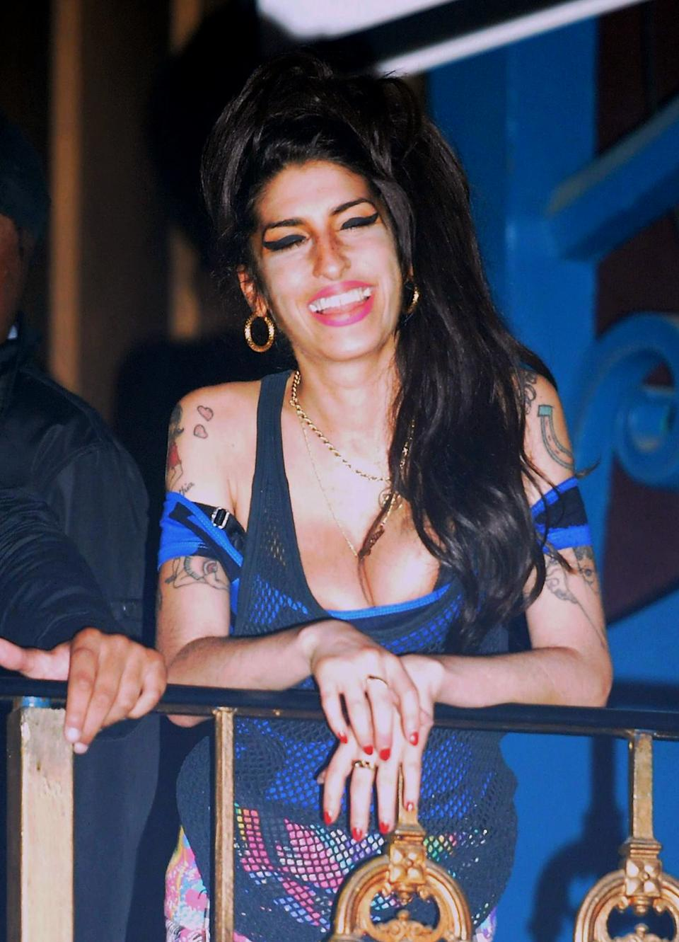 Amy Winehouse watches the Libertines perform on stage at the Forum in Highgate, London.