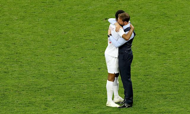 Thanks, boss: England manager Gareth Southgate hugs Marcus Rashford after the final whistle.
