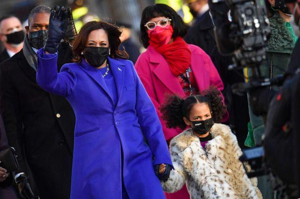 PHOTO: Vice President Kamala Harris holds the hand of her grand niece as they walk up Pennsylvania Avenue to enter the White House in Washington after Joe Biden and Kamala Harris were sworn in at the US Capitol on Jan. 20, 2021. (Nicholas Kamm/AFP via Getty Images)