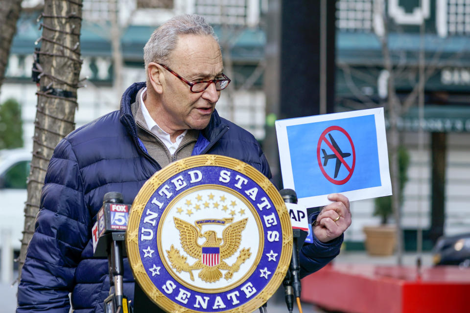 Senate Minority Leader Chuck Schumer, D-N.Y., speaks to reporters during a news conference, Tuesday, Jan. 12, 2021, in New York. Schumer demanded individuals who stormed the U.S. Capitol last week be placed on a no-fly list by federal law enforcement. (AP Photo/Mary Altaffer)