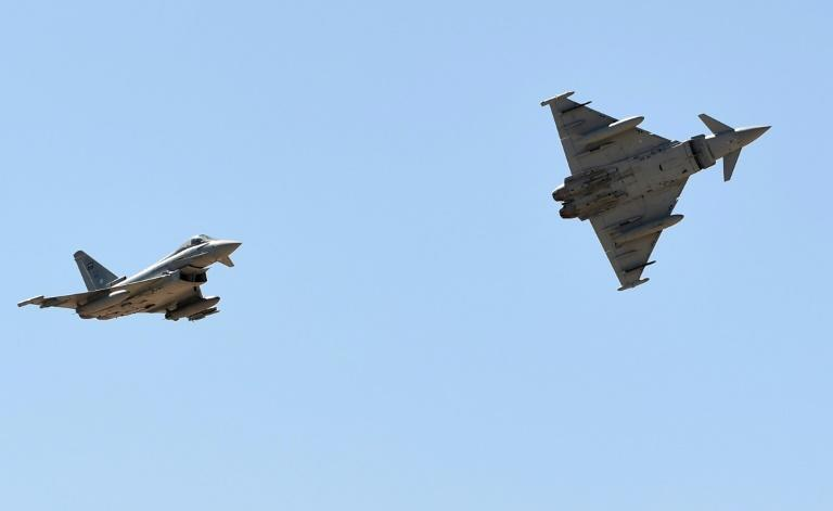 Eurofighter Typhoon jets belonging to the Saudi Air Force perform at a ceremony in 2017