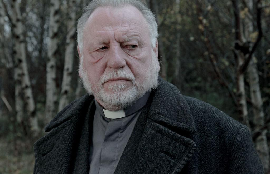 "Kenneth Cranham as Vicar Oddie in BBC America's ""In The Flesh."""