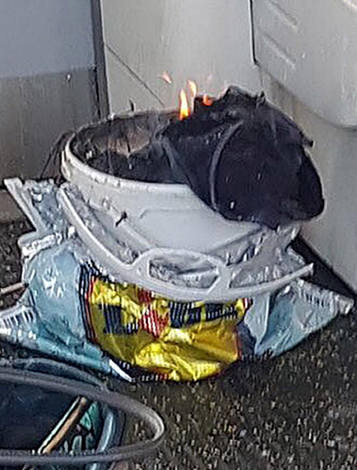<p>A social media image shows a flaming white bucket inside the doors of a tube carriage, which is suspected to be the object which exploded. (PA) </p>