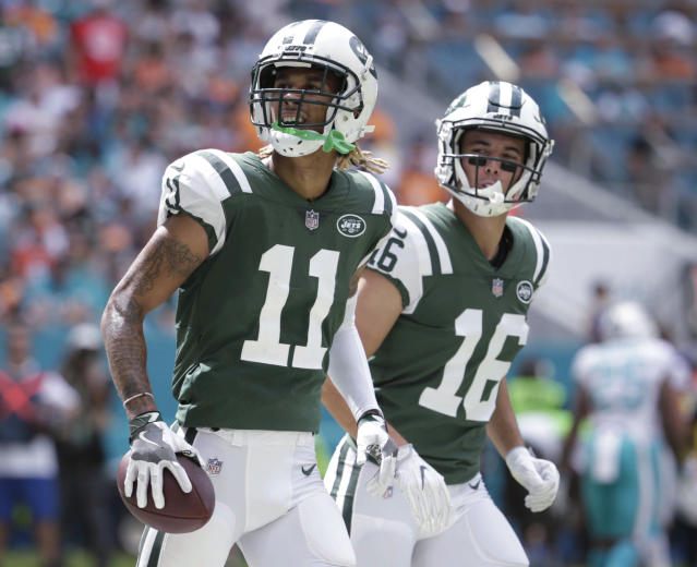 FILE - In this Oct. 22, 2017, file photo, New York Jets wide receivers Robby Anderson (11) and Chad Hansen (16) run to the sideline after Anderson scored a touchdown during the first half of an NFL football game against the Miami Dolphins in Miami Gardens, Fla. Anderson set career highs with 63 catches, 941 yards receiving and seven touchdowns last year, his second NFL season. But off-field issues have led to some questions about his character and long-term well-being--and whether this is a developing pattern of behavior. (AP Photo/Lynne Sladky, File)