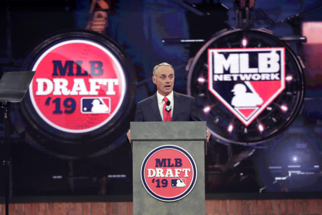 FILE - In this June 3, 2019, file photo, Baseball Commissioner Rob Manfred speaks during the first round of the baseball draft in Secaucus, N.J. Baseballs amateur draft this week will look much different because of the coronavirus pandemic, and more permanent changes could be coming soon. (AP Photo/Julio Cortez, File)