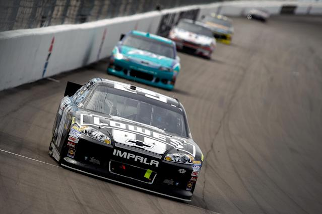 LAS VEGAS, NV - MARCH 11: Jimmie Johnson, driver of the #48 Lowe's/Kobalt Tools Chevrolet, leads the field during the NASCAR Sprint Cup Series Kobalt Tools 400 at Las Vegas Motor Speedway on March 11, 2012 in Las Vegas, Nevada. (Photo by Todd Warshaw/Getty Images for NASCAR)