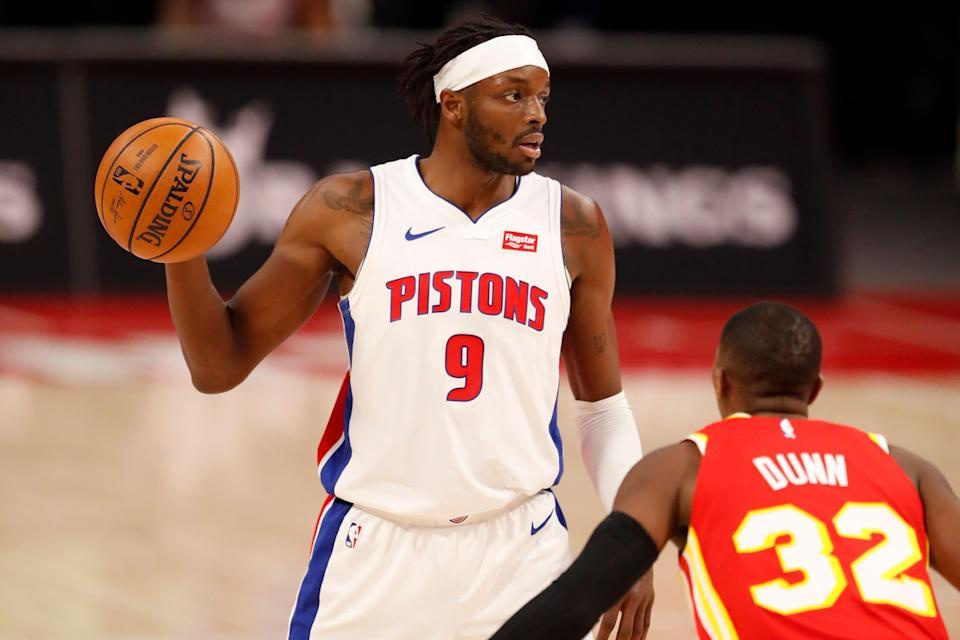 Pistons forward Jerami Grant controls the ball while defended by Hawks guard Kris Dunn during the third quarter of the Pistons' 100-86 win on Monday, April 26, 2021.