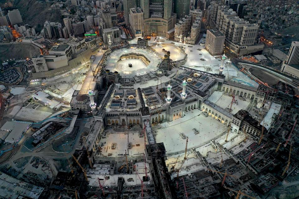 Image: The Grand Mosque and Kaaba in the holy city of Mecca on May 24, 2020. Saudi Arabia began a five-day curfew on May 23 after coronavirus infections more than quadrupled since the start of Ramadan. (AFP - Getty Images)