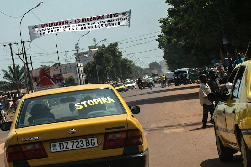 A banner for the upcoming constitutional referendum hangs above a street in Bangui, Central African Republic on December 8, 2015 The country is preparing to hold a referendum on December 13 on a proposed new constitution ahead of nationwide polls on December 27, following years of violence after a bloody coup in 2013. The Transitional Constitutional Court announced on December 8, 2015 the list of the candidates admitted to compete in the December 27 Presidential Elections. (AFP Photo/Marco Longari)