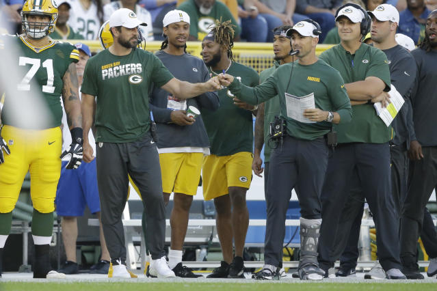 Green Bay Packers quarterback Aaron Rodgers and coach Matt LaFleur bump fists during the first half of the team's NFL preseason football game against the Houston Texans on Thursday, Aug. 8, 2019, in Green Bay, Wis. (AP Photo/Jeffrey Phelps)