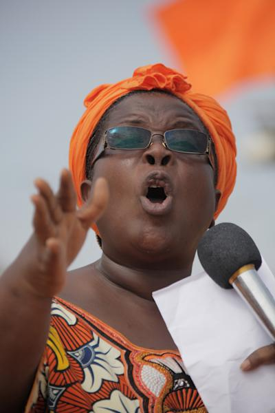 In this Saturday, Aug. 25, 2012 photo, female opposition leader Isabelle Ameganvi calls on Togo's women to observe a one-week sex strike beginning Monday, in Lome, Togo. The female wing of a civil rights group is urging women in Togo to stage a week-long sex strike to demand the resignation of the country's president. (AP Photo/ Erick Kaglan)