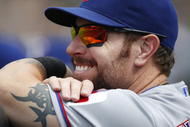 FILE - In this July 22, 2015, file photo, Texas Rangers left fielder Josh Hamilton (32) looks on during a baseball game against the Colorado Rockies in the seventh inning in Denver. Hamilton will be inducted into the Rangers Hall of Fame on Aug. 17, 2019. (AP Photo/David Zalubowski, File)
