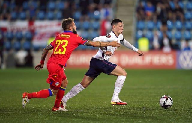 Phil Foden evades an opponent