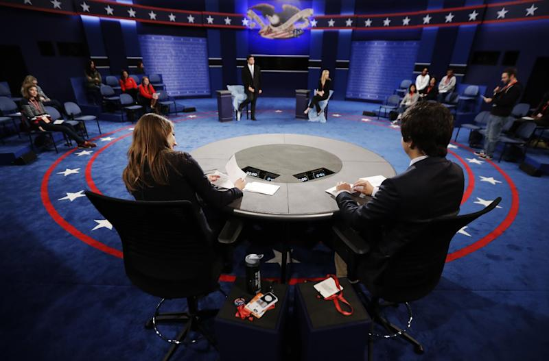 Students stand in on the stage as preparations are made for the second presidential debate between Republican presidential nominee Donald Trump Democratic presidential nominee Hillary Clinton at Washington University in St. Louis, Saturday, Oct. 8, 2016. (AP Photo/Julio Cortez)
