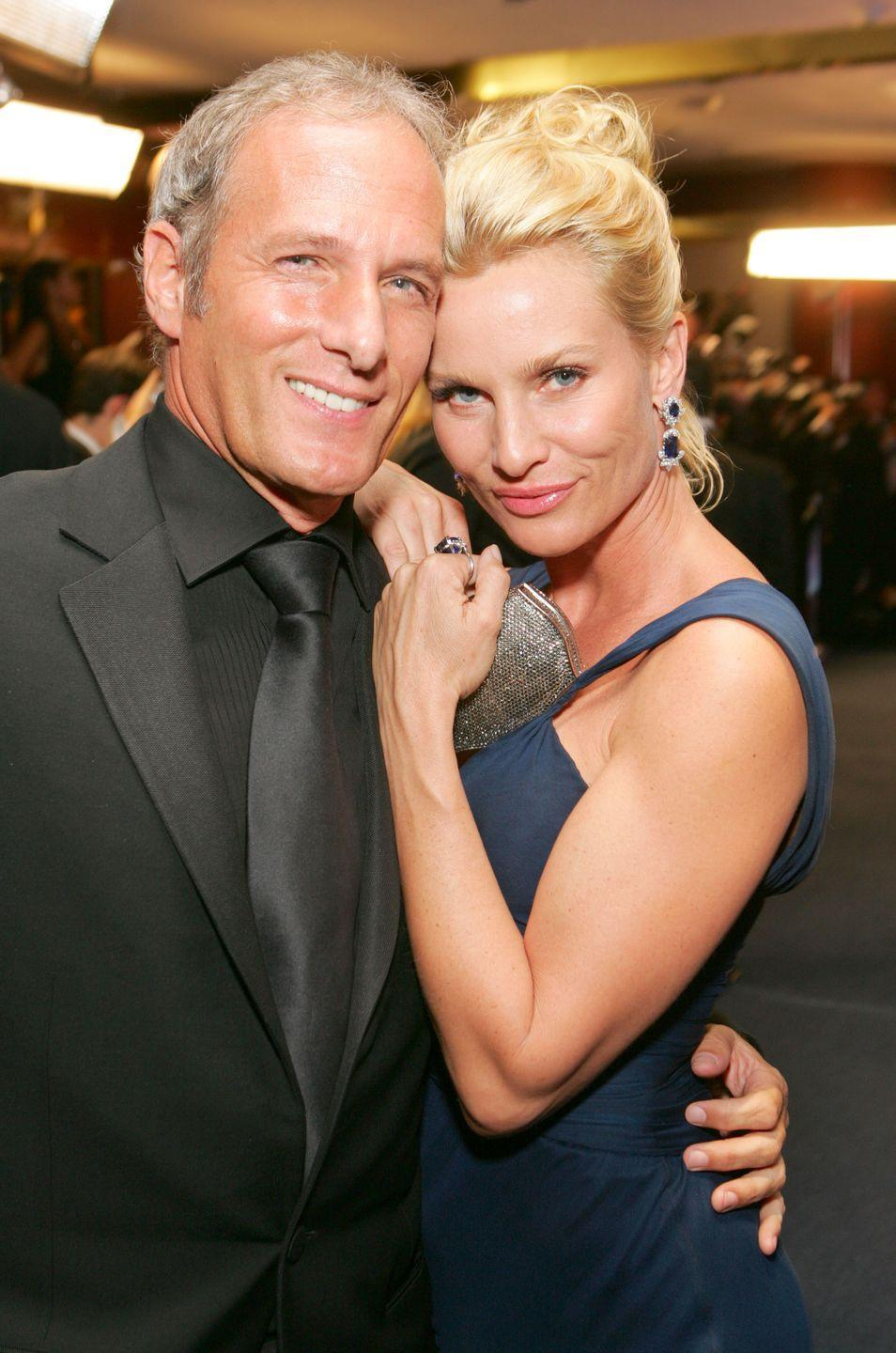 """<p>2008 marked the end of a longtime relationship between the musician and his <em>Desperate Housewives </em>fiancée<em>. </em>The couple dated for five years, beginning in 1992. Then they re-connected in 2005, getting engaged the following year. They confirmed their split in August 2008 to <em><a href=""""https://people.com/celebrity/nicollette-sheridan-michael-bolton-end-engagement/"""" rel=""""nofollow noopener"""" target=""""_blank"""" data-ylk=""""slk:People"""" class=""""link rapid-noclick-resp"""">People</a></em>.<br></p>"""