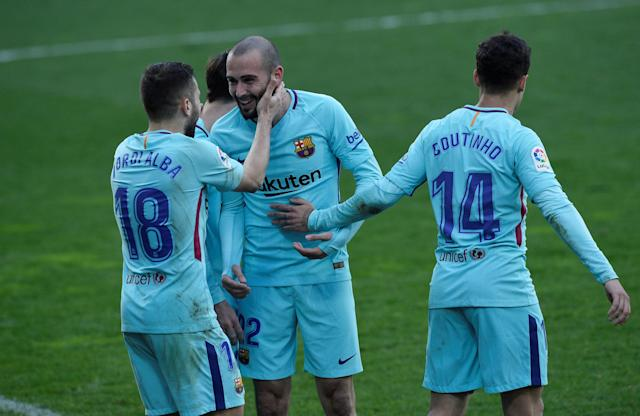 Soccer Football - La Liga Santander - Eibar vs FC Barcelona - Ipurua, Eibar, Spain - February 17, 2018 Barcelona's Jordi Alba celebrates scoring their second goal with Aleix Vidal and Philippe Coutinho REUTERS/Vincent West