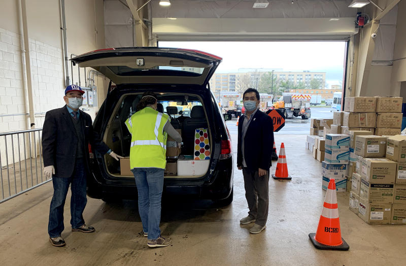 James Chuang, an adviser of Taiwan's Overseas Community Affairs Council in New York, and others load up a van to deliver supplies to Queens' hospitals. (Courtesy James Chuang)