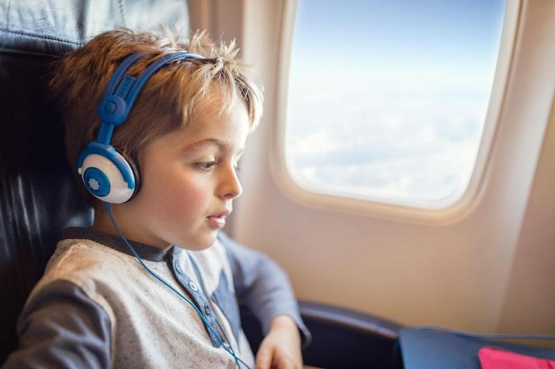 How to keep a kid entertained on a long-haul flight. Photo: Getty Images