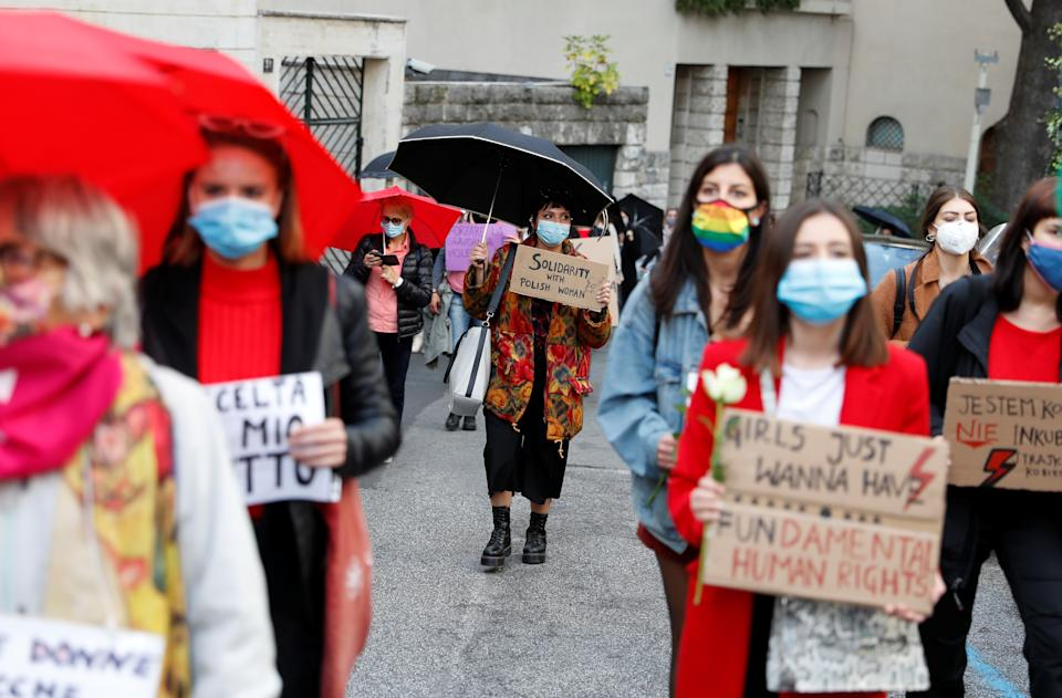Women hold a demonstration outside the Polish embassy in solidarity with protesters in Poland who are demonstrating against a court ruling that further limits the country's highly restrictive abortion law, in Rome, Italy, October 28, 2020. REUTERS/Yara Nardi