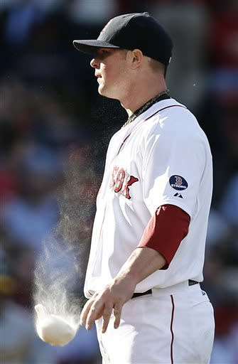 Boston Red Sox starting pitcher Jon Lester throws down the rosin bag after not getting a called strike during the fourth inning of a baseball game against the Oakland Athletics at Fenway Park in Boston, Wednesday, April 24, 2013. (AP Photo/Winslow Townson)