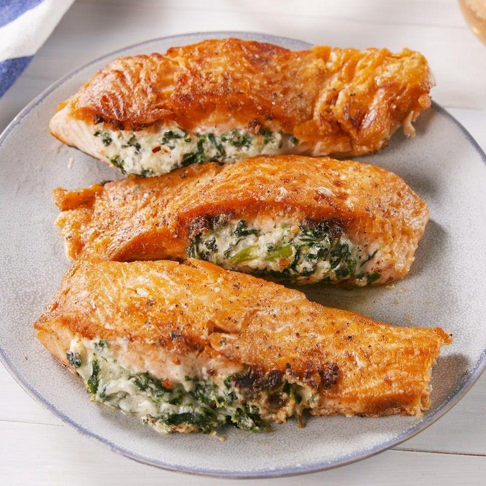 """<p>If you're skeptical about the combination of cheese and salmon, don't be. We promise you, it's AMAZING. </p><p>Get the <a href=""""https://www.delish.com/uk/cooking/recipes/a35547684/creamed-spinach-stuffed-salmon-recipe/"""" rel=""""nofollow noopener"""" target=""""_blank"""" data-ylk=""""slk:Creamed Spinach–Stuffed Salmon"""" class=""""link rapid-noclick-resp"""">Creamed Spinach–Stuffed Salmon</a> recipe.</p>"""