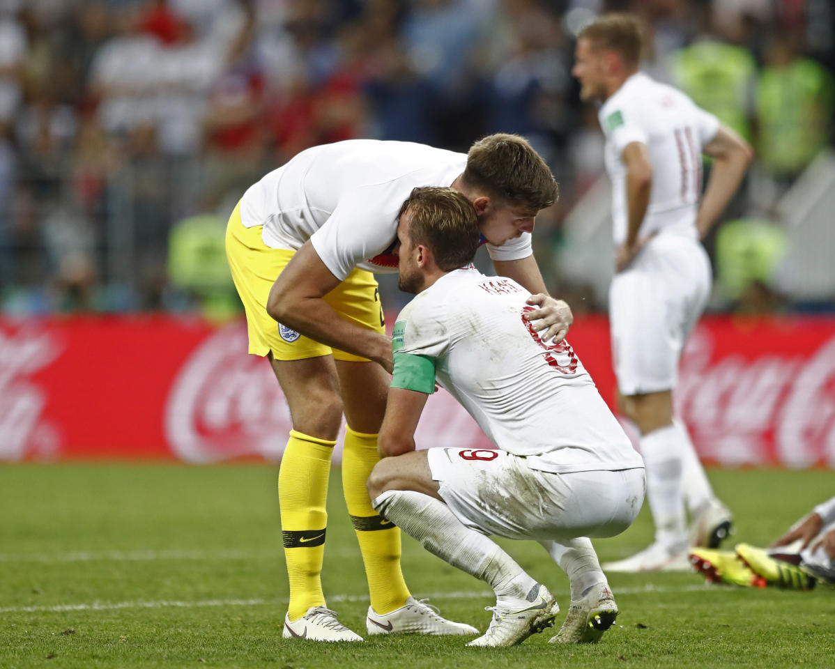 <p>England goalkeeper Nick Pope comforts Harry Kane </p>