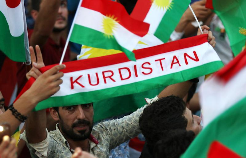 Iraqi Kurds fly Kurdish flags