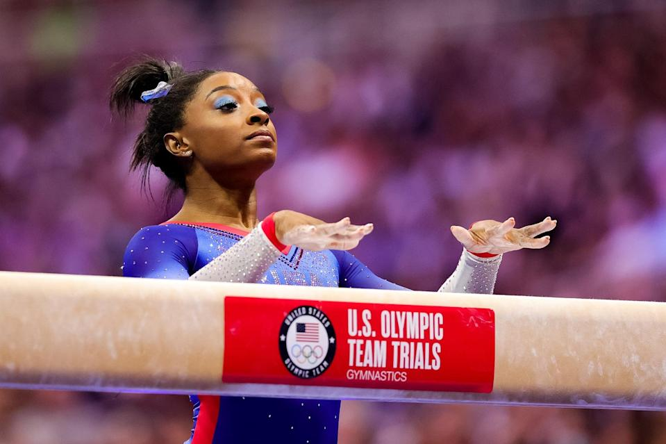 """<p>Biles, 24, needs no introduction, and she clinched her spot on the Olympic team by winning first in the all-around at Trials. She has won every all-around competition she's entered since 2013 and is the <a href=""""https://www.popsugar.com/fitness/How-Many-World-Championship-Medals-Has-Simone-Biles-Won-46503573"""" class=""""link rapid-noclick-resp"""" rel=""""nofollow noopener"""" target=""""_blank"""" data-ylk=""""slk:most decorated gymnast in World Championship history"""">most decorated gymnast in World Championship history</a>. She has a <a href=""""https://www.popsugar.com/fitness/simone-biles-wins-2021-us-gymnastics-championships-48359320"""" class=""""link rapid-noclick-resp"""" rel=""""nofollow noopener"""" target=""""_blank"""" data-ylk=""""slk:record seven national all-around titles"""">record seven national all-around titles</a>, and if she wins four medals of any kind at Tokyo she will lock in her place as the gymnast with the <a href=""""http://theathletic.com/news/simone-biles-wins-seventh-national-all-around-at-us-gymnastics-championship/Fevkuc9j6pQO"""" class=""""link rapid-noclick-resp"""" rel=""""nofollow noopener"""" target=""""_blank"""" data-ylk=""""slk:most combined World Championship and Olympic medals ever"""">most combined World Championship and Olympic medals ever</a>.</p>"""