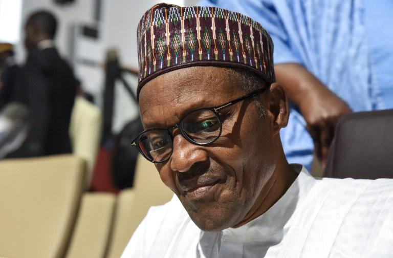 South Africa's financial capital and surrounding areas were rocked by a surge of deadly attacks against foreigners, many directed against Nigerian-owned businesses and properties; Nigerian president Muhammadu Buhari in an image from July 7, 2019