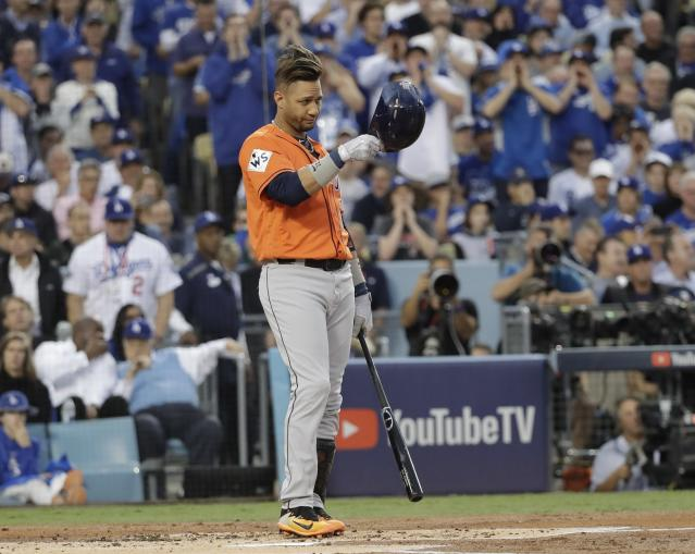 Houston Astros' Yuli Gurriel tips his hat as he gestures to Los Angeles Dodgers starting pitcher Yu Darvish during the first inning of Game 7 of baseball's World Series Wednesday, Nov. 1, 2017, in Los Angeles. (AP Photo/David J. Phillip)