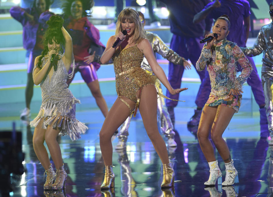 Taylor Swift, center, was scheduled to open SoFi Stadium with a pair of concerts in late July. The cancellation of those events could signal how the NFL season shapes up. (Chris Pizzello/Invision/AP)