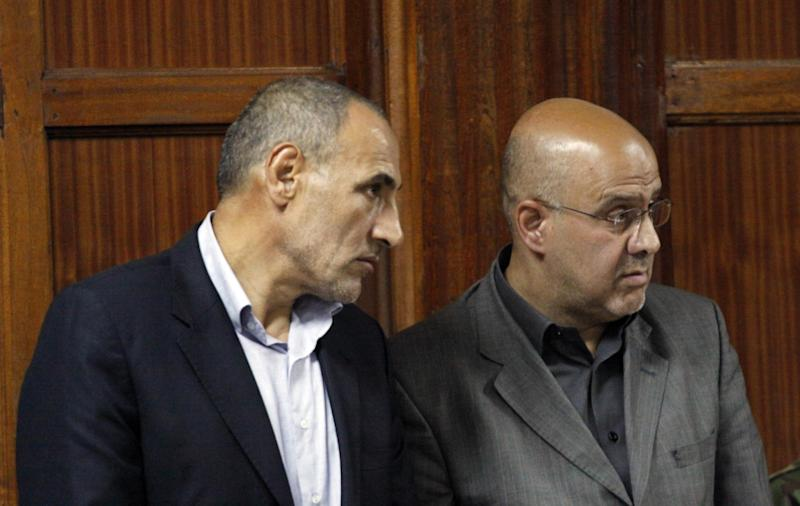 """Two Iranian nationals Ahmed Abolfathi Mohammed, right, and Sayed Mansour Mousavi, left, as they await judgement inside the magistrate court in Nairobi, Kenya, Monday, May 6, 2013. The two men were convicted of plotting attacks against western and Israeli targets, to life in prison. The two Iranian nationals Ahmad Abolfathi Mohammad and Sayed Mansour Mousavi were arrested in June 2012, and prosecutors said the two had explosives """"in circumstances that indicated they were armed with the intent to commit grievous harm"""", and they are suspected of involvement in attacks, or thwarted attacks, around the globe, including in Azerbaijan, Thailand and India. (AP Photo/Khalil Senosi)"""