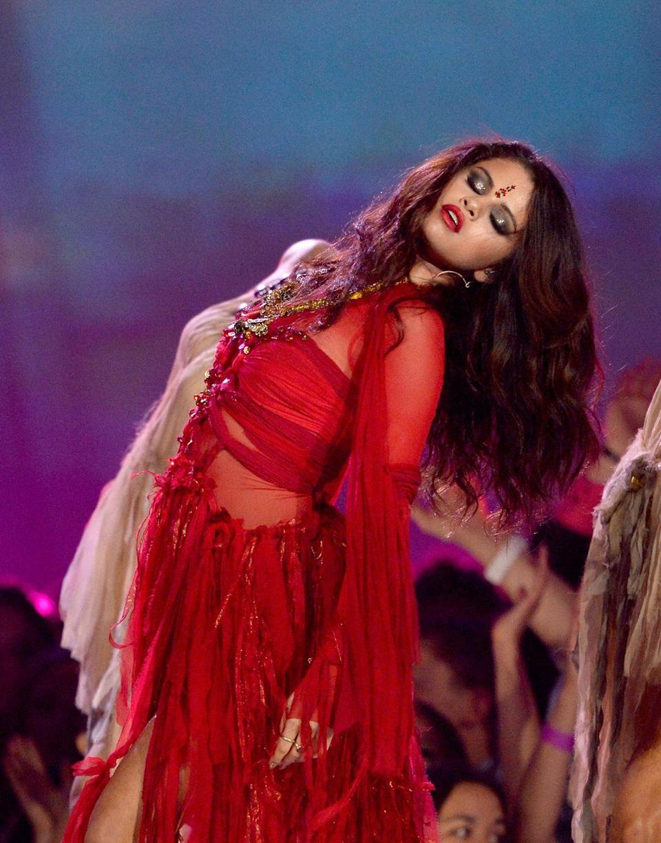 """<p>While performing her song """"Come and Get It,"""" at the 2013 MTV Movie Awards, Selena Gomez wore a bindi and an outfit that appeared to be Bollywood-inspired. Hindu statesman Rajan Zed said of <a href=""""https://www.today.com/popculture/selena-gomez-causes-controversy-wearing-bindi-mtv-movie-awards-I533548"""" rel=""""nofollow noopener"""" target=""""_blank"""" data-ylk=""""slk:the performance"""" class=""""link rapid-noclick-resp"""">the performance</a>, """"The bindi on the forehead is an ancient tradition in Hinduism and has religious significance ... It is not meant to be thrown around loosely for seductive effects or as a fashion accessory aiming at mercantile greed. Selena should apologize and then she should get acquainted with the basics of world religions.""""</p>"""