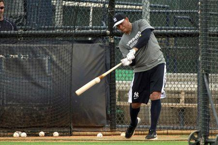 New York Yankees third baseman Alex Rodriguez (13) makes contact during batting practice of the afternoon  workouts at New York Yankee Minor League Complex. Mandatory Credit: Tommy Gilligan-USA TODAY Sports