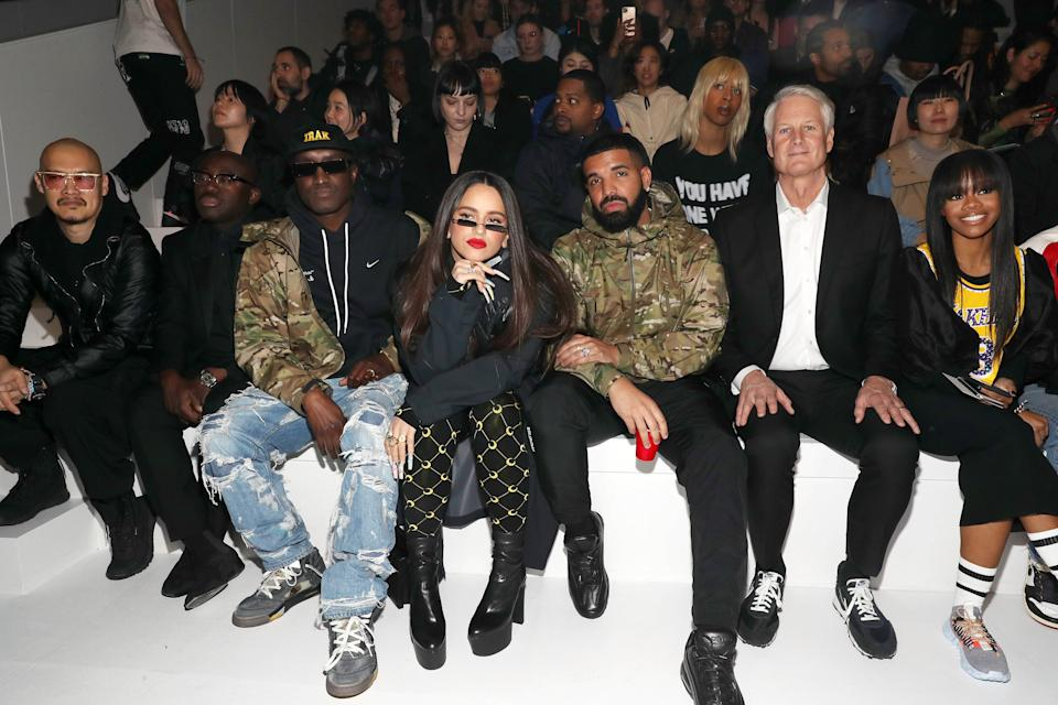 NEW YORK, NEW YORK - FEBRUARY 05:(L - R) Edward Enninful, Virgil Abloh, Rosalia, Drake, John Donahoe, and Gabby Douglas attend the 2020 Tokyo Olympic collection fashion show at The Shed on February 05, 2020 in New York City. (Photo by Bennett Raglin/Getty Images)