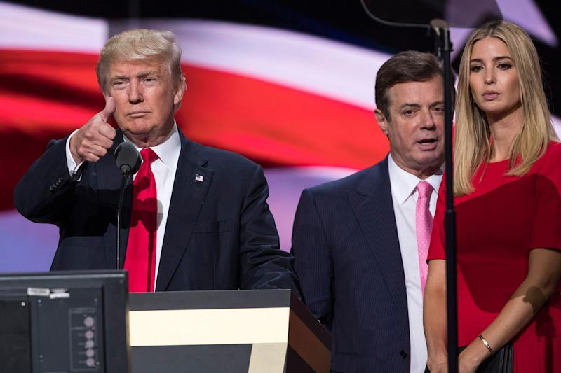 Paul Manafort stands between President Donald Trump and daughter Ivanka Trump in a picture taken during the 2016 Republican convention in Cleveland.