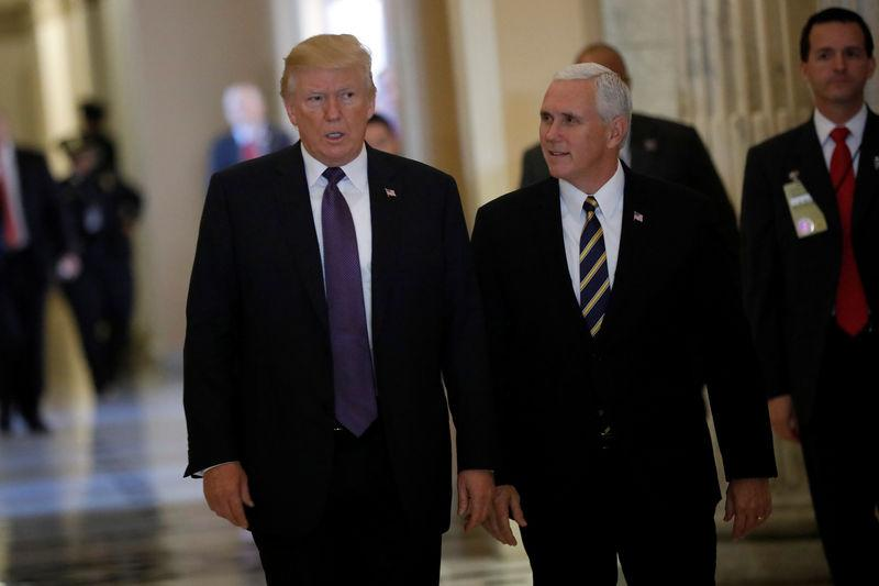 """U.S. President Donald Trump and Vice President Mike Pence depart the U.S. Capitol after meeting with House Republicans ahead of their vote on the """"Tax Cuts and Jobs Act"""" in Washington"""