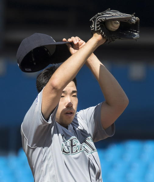 Seattle Mariners starting pitcher Yusei Kikuchi pauses before throwing to last Toronto Blue Jays hitter in the ninth inning of their baseball game in Toronto Sunday Aug. 18, 2019. Kikuchi pitched a complete game shutout to defeat the Blue Jays. (Fred Thornhill/The Canadian Press via AP)