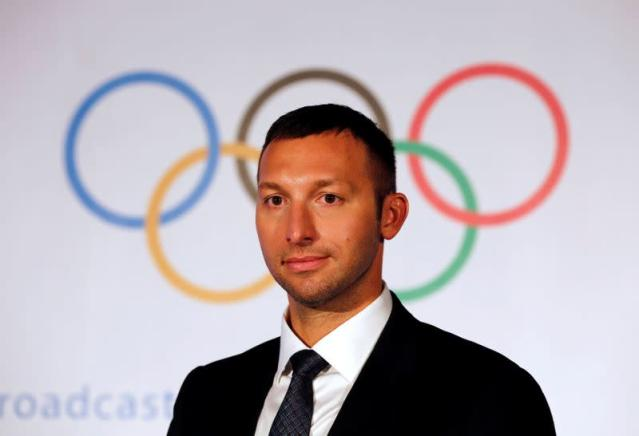 Australian swimmer Ian Thorpe leaves after attending a news conference in Mumbai