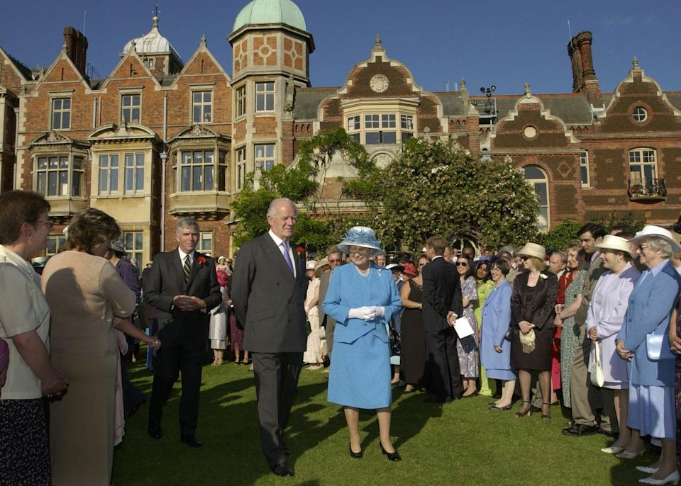 With the Queen at Sandringham in 2002 - Anwar Hussein/Getty Images